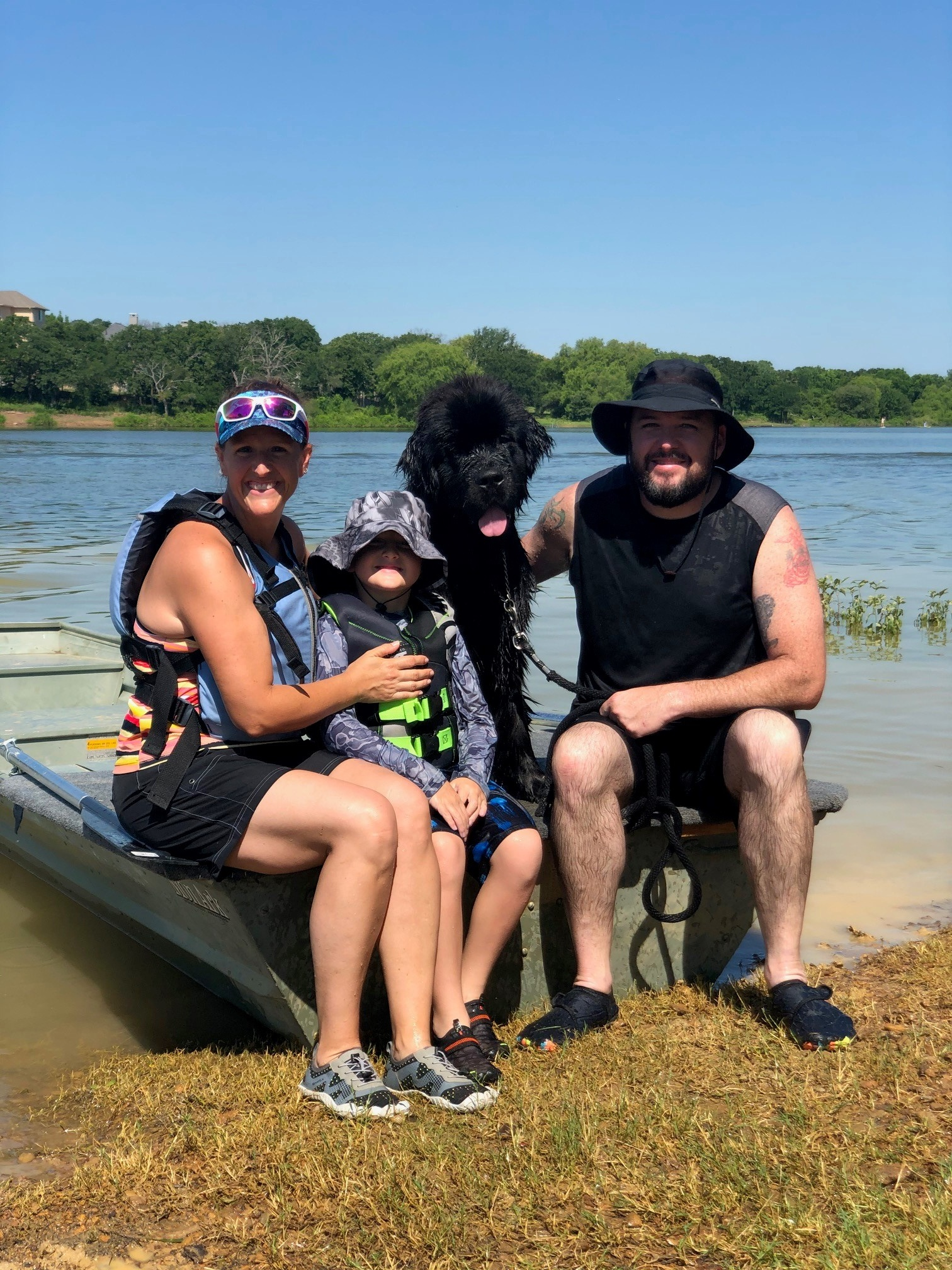 Amy Little and her family with their Newfoundland retriever Rutter