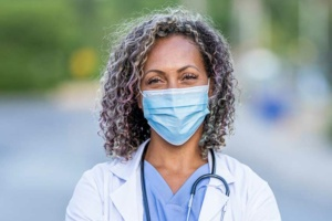 a physician with healthcare career satisfaction