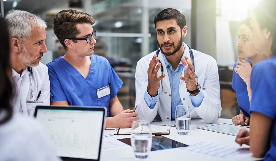 foreign-born physician consulting with colleages