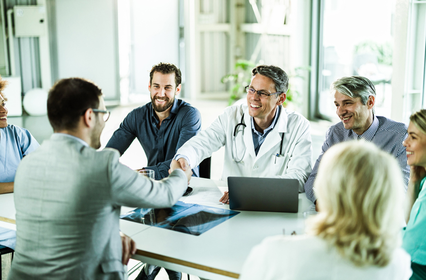 medical leaders and a physician in a behavioral interview
